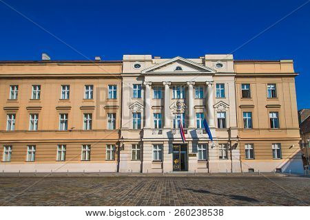 Palace building of Croatian parliament with flags of Craotia and European Union in Zagreb Croatia poster
