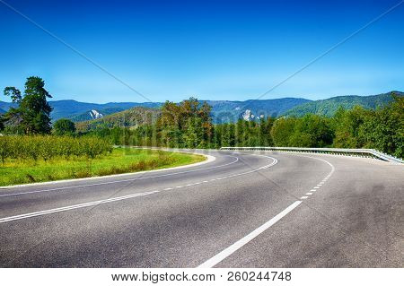 The Road In Mountainous Terrain, Sharp Turns. Summer Landscape. Serpentine Road. Asphalt Coating. Na