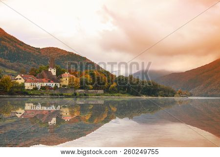 Quaint Small Town On The Shore Of The Danube River In Austria In The Fall
