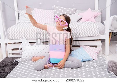Subscribe Her Vlog. Vlogger Streaming Video. Girl Child Sit On Bed In Her Bedroom And Taking Selfie