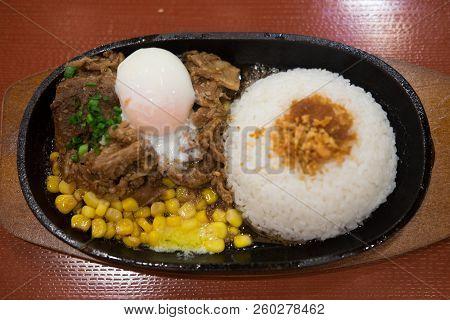 Pork Teppanyaki With Egg And Corn In Hot Plate. Japanese Food