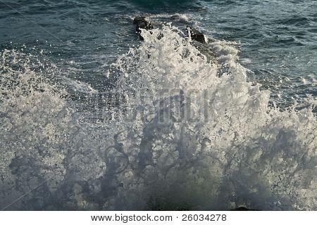 Big wave splash over rocky coast