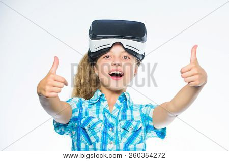 Kid Girl With Vr Glasses. Little Gamer Concept. Child Play Virtual Games With Modern Device. Explore