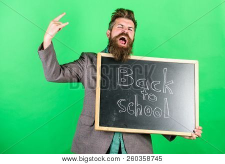 Rock This School.. Teaching Occupation Demands Talent And Experience. Teacher Welcomes Students Whil