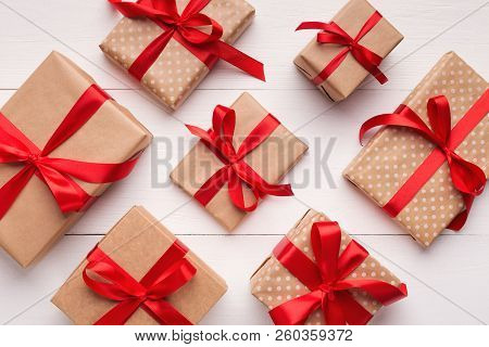 Christmas Gift Boxes Pattern On White Wooden Background, Winter Holiday Pattern, Top View