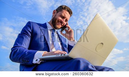 Sales Manager Responsibilities. Man Formal Suit Work With Laptop While Speak On Phone. Businessman S