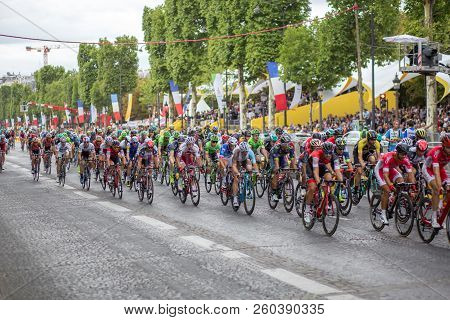 Paris, France - July 23, 2017: Group Of Cyclists On Avenue Des Champs-elysees For The Final Stage Of
