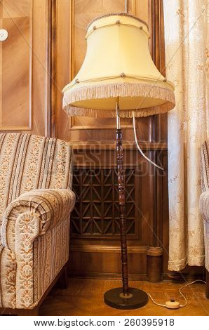 Retro Chair And Floor Lamp Torchere. A Torchere, Or Torch Lamp, Is A Lamp With A Tall Stand Of Wood