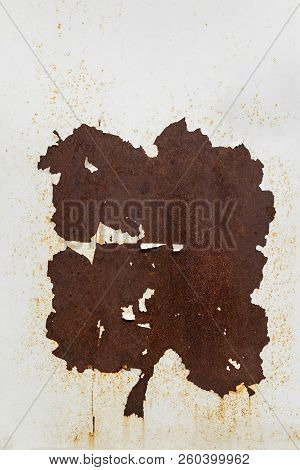 Rusty Metal Sheet. Metal Surface With Peeling White Paint And Rust. Corroded White Metal Background.