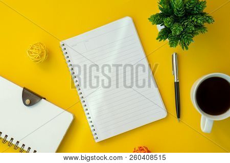 Notebook With Text Copy Space On Yellow Working Desk. Elegant Minimal Workspace Flat Lay.