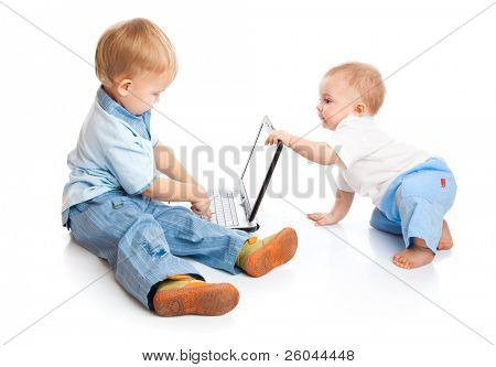 Concept of little businessman. Little children and laptop. Isolated on white background
