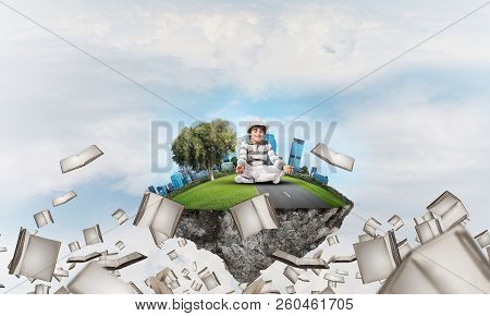 Young little boy keeping eyes closed and looking concentrated while meditating on flying island among flying books with cloudy skyscape on background. 3D rendering. poster