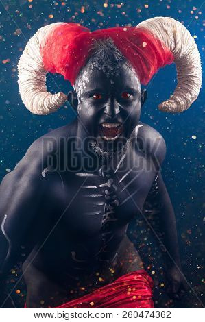 Fiery demon. A terrible demon with horns poster