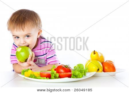 A boy is eating an apple. Isolated on a white background