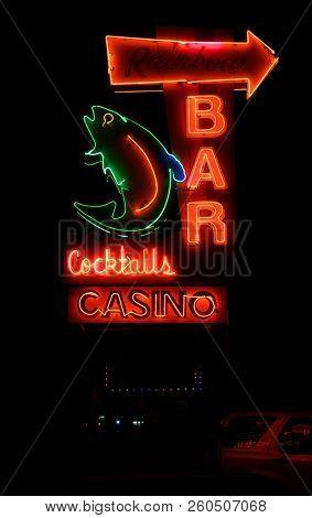 KALISPELL, MONTANA, USA - September 26, 2018: Rainbow Bar and Casino's neon sign lit up at night