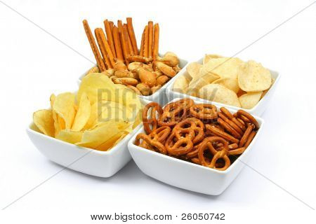 Salty snacks in square bowls, isolated on white