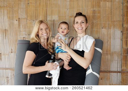 Portrait Of Young Caucasian Women With Adorable Little Boy Smiling At Camera Cheerfully While Standi