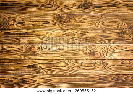 Rustic Wood Background Texture Of Parallel Boards With A Decorative Woodgrain Pattern For Use As A T