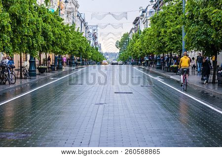 Vilnius, Lithuania - May 17, 2014: City Center Of Vilnius. Wet Gediminas Avenue After Heavy Spring R