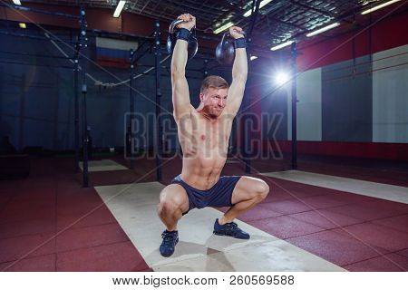 Cross Training Fit. Fitness Man Doing A Weight Training By Lifting Kettlebell. Young Athlete Doing K