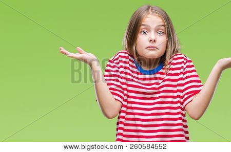Young beautiful girl over isolated background clueless and confused expression with arms and hands raised. Doubt concept.
