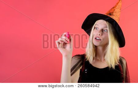 Halloween. Girl In Witch Dress With Marker In Hand. Writing With Pen. Halloween Witch. Halloween Con