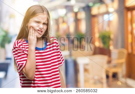 Young beautiful girl over isolated background touching mouth with hand with painful expression because of toothache or dental illness on teeth. Dentist concept.