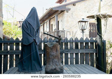 Medieval Executioner In Black Robe On Display