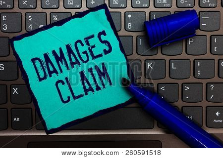 Word writing text Damages Claim. Business concept for Demand Compensation Litigate Insurance File Suit Turquoise paper keyboard Inspiration communicate idea messages blue markers. poster