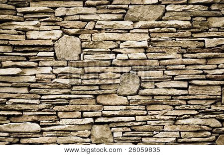 a  wall of flagstone bricks