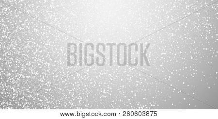 Random White Dots Christmas Background. Subtle Flying Snow Flakes And Stars On Light Grey Background