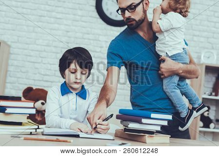 Difficulties Tasks.dad. Helps Do Homework. Spends Time With Son. Father. Father Two Boys. Upbringing