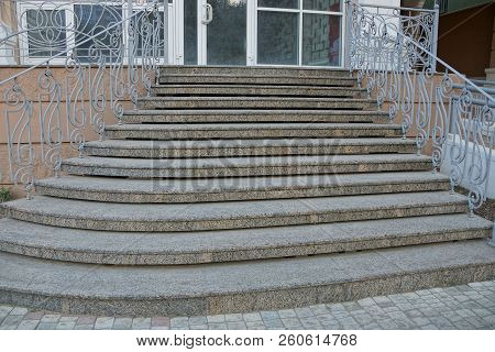 Gray Concrete Steps And Iron Railings At The Sidewalk Near The Glass Wall