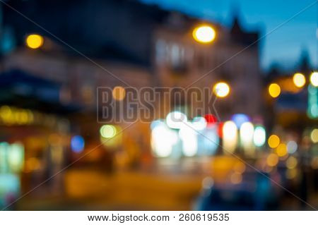 Beautiful Evening Scenery Of European Town. Street With Bright Lanterns. Abstract Blur Background. B