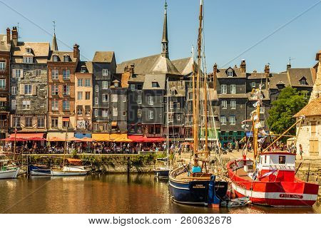 Honfleur, France - 2018. Scenic View Of The Honfleur Harbour In Normandy, France. Color Houses And T