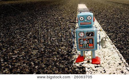 tin robot on a long road