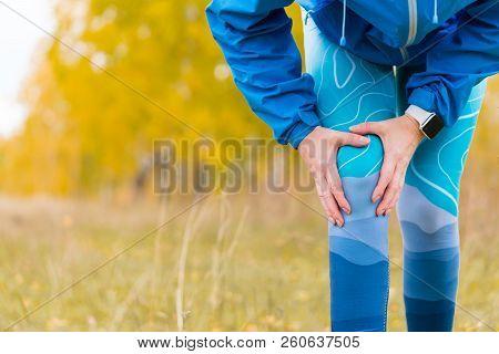 Arthritis Athlete. Injuries - Sports Running Knee Injury Woman.  Closeup Of Leg, And Knee Outdoors.