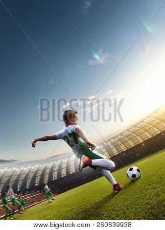 Children Soccer Player In Action In Stadium