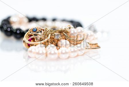 Real Gold Jewlery, Diamonds, Gems, Rings, Neckless With Pearls Close Up Shot , White Background, On