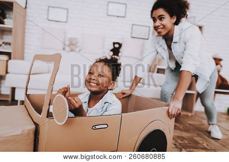 Mother And Young Girl Drive With Mother. People Play With Car. Little Girl Drive Car. Young People A