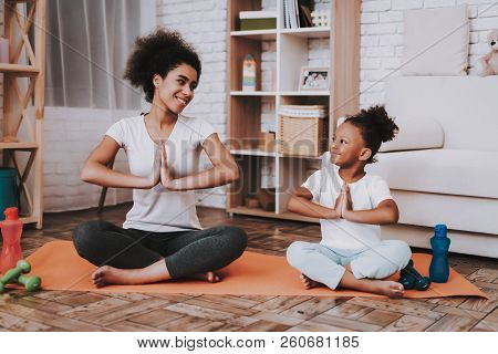 Mother With Young Girl Training. Smile Girl And Young Mother Sport For All Family. Yoga For Family.