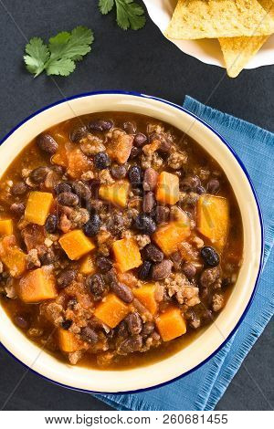 Homemade Chili Con Carne With Mincemeat, Red And Black Beans, Tomato Sauce And Pumpkin In Enamel Bow