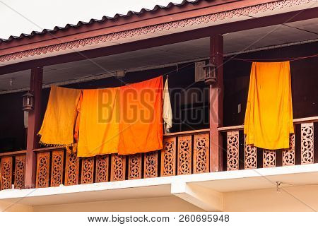 Orange Monk's Clothes