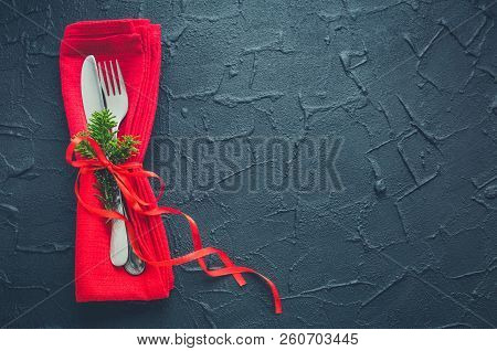 Christmas And New Year Holiday Celebration Table Setting On Black Background. Place Setting For Chri