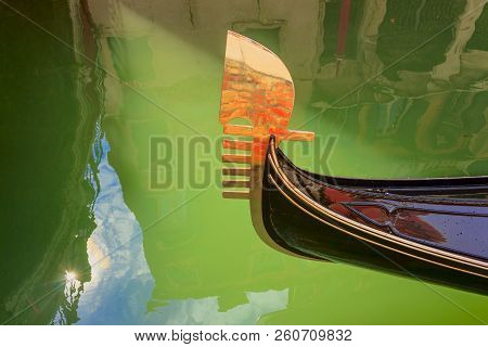 Venice: Reflections, Lights And Colors. Particular Of The Iron Prow-head Of The Gondola. The Ornamen