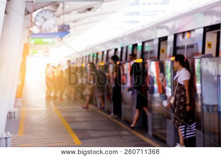 Blurry Of People Getting On And Getting Out Electric Skytrain With Automatic Gateway