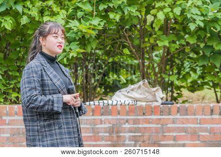 Daejeon, South Korea; September 20, 2018:  Unidentified Korean Female Performer Singing A Song On Th