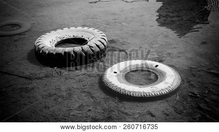 Abandoned Tire On The Water Sea Or Lake Pond With Black And White Style Color In Indonesia