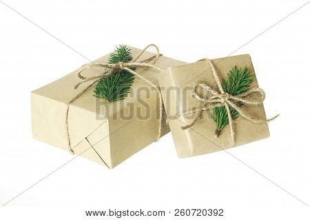 Christmas Present Or Gift Box Isolated. Wrapped Vintage Craft Paper Gift Box Decorated With Sprig Of