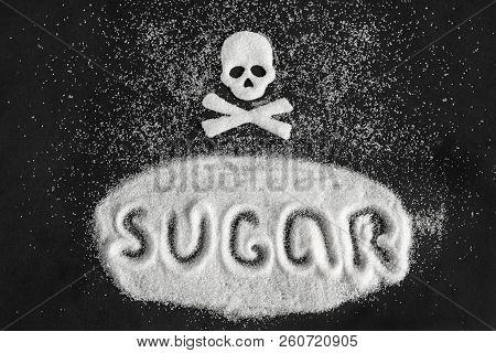 Text Sugar And Skull Shape From Sugar On Black Background, Concept Sugar And Sweet Leads To Diabetes